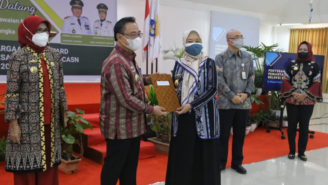 MI/Cri Canon Ria Dewi